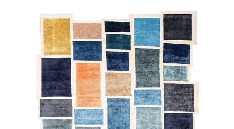 Designed by Luca Nichetto, this exquisite rug is an excellent choice for a contemporary interior, with its multi-hued boxes inspired by the temporary look of a Google page while waiting for Google to load images onto the screen. This playful and