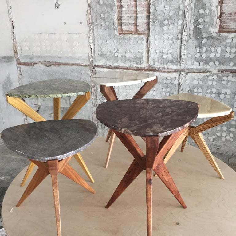 Plettro side table is a 50s wood and marble top side table. It's named after the guitar plectrum shape of the stone.  Plettro side table has Sputnik legs that accommodate the stone top like a gem mounted on a ring  Plettro can be made in different