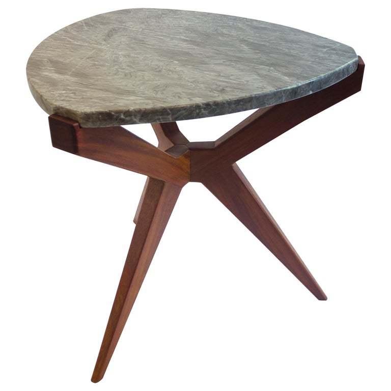 Plettro side table is a 1950s wood and marble top side table. It's named after the guitar plectrum shape of the stone.  Plettro side table has Sputnik legs that accommodate the stone top like a gem mounted on a ring  Plettro can be made in
