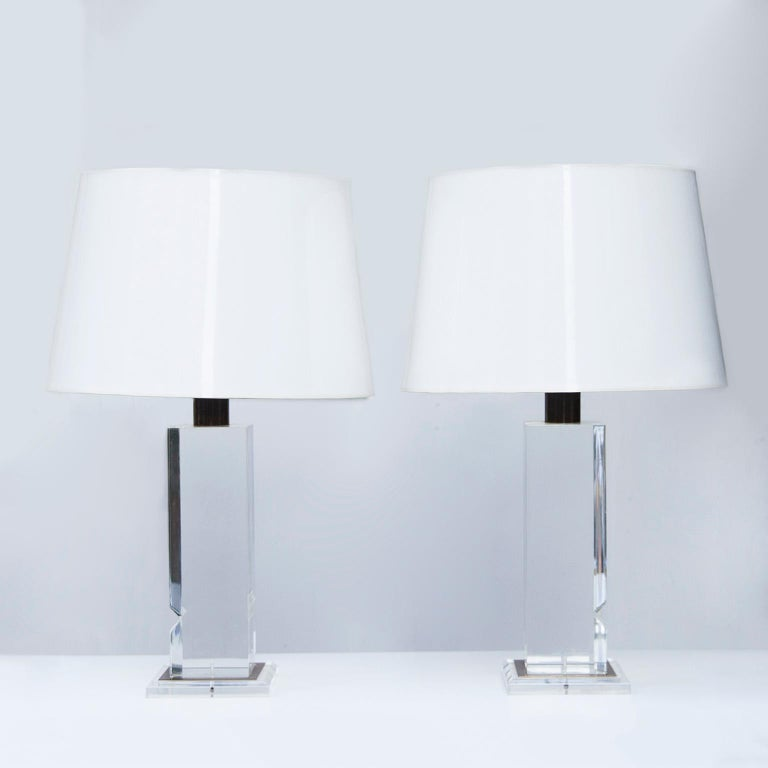 Wonderful French Lucite table lamps new white and inside golden paper shades, France 1970s.