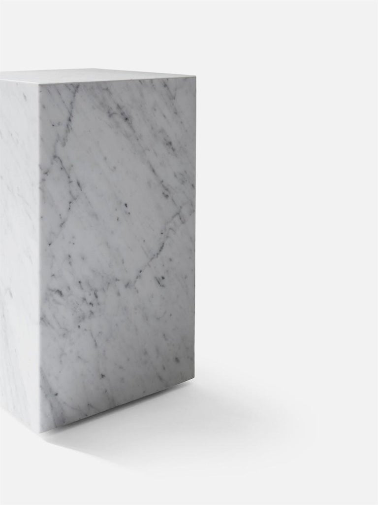 As versatile as it is timeless, the marble Plinth serves the dual purpose of being a beautiful, sculptural piece on its own and highlighting whatever objects rest upon it. The honed marble carries an air of sophistication and elegance to elevate any