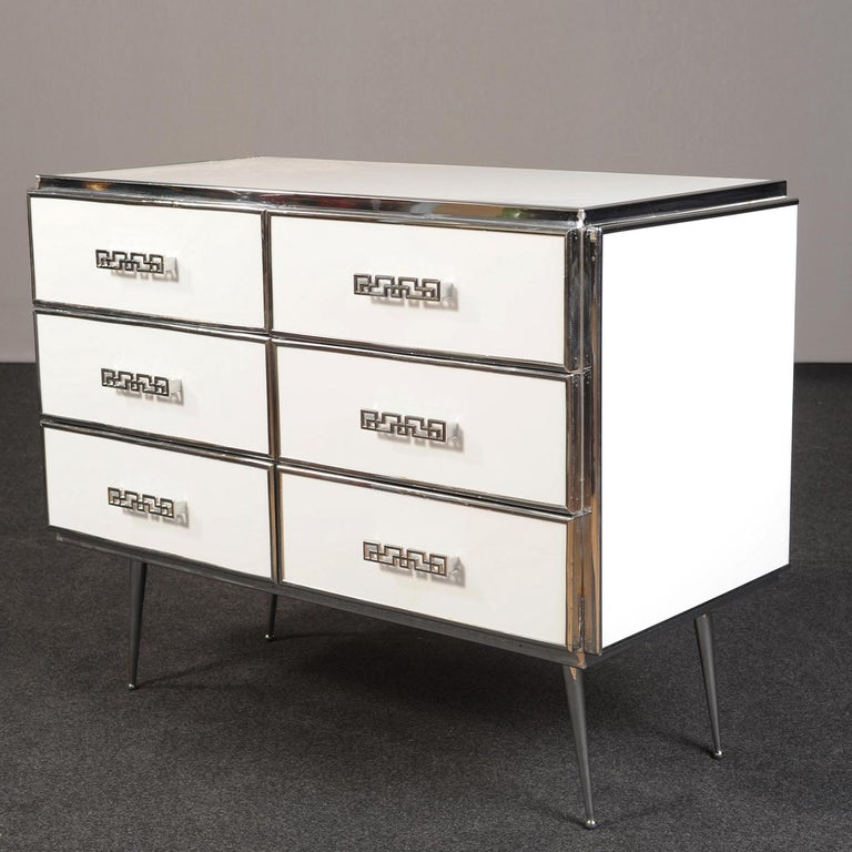 In this statement-making dresser, Art Deco inspiration merges with the brightness of pure-white surfaces covered in a glossy white acrylic film for chromatic consistency and increased protection. Ideal for elevating dark-toned color palettes, the