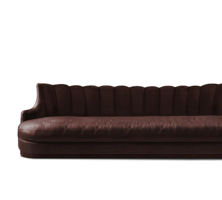 PLUM is a throwback to the past with a contemporary touch. With matte aged brass legs, this fully upholstered sofa celebrates luxury and opulence highlighted by the synthetic leather that surrounds it. Place it in a modern living room and this