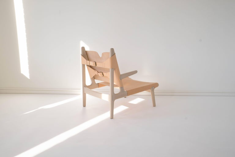 Sun at Six is a contemporary furniture design studio that works with traditional Chinese joinery masters to handcraft our pieces using traditional joinery. Vegetable tanned leather will patina with age. Exposed joinery throughout. Also available in