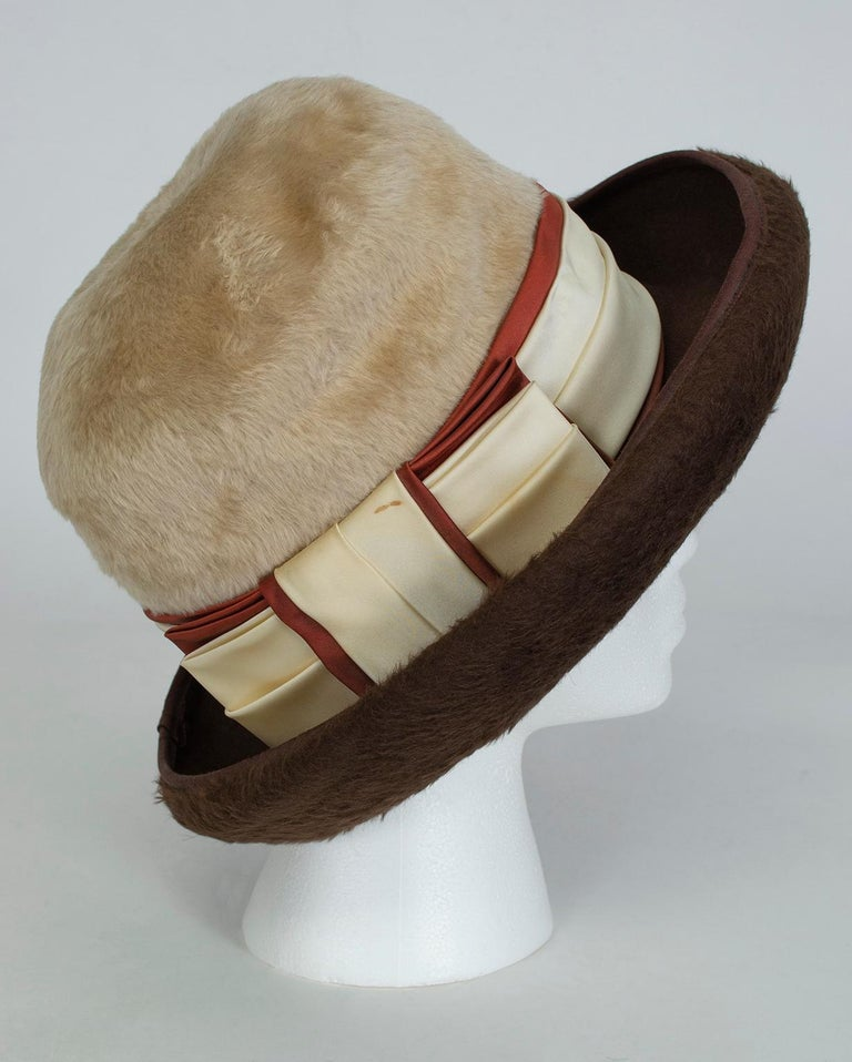 Like Fedoras, bowler hats look particularly good on women because of their typically masculine association. This one takes androgyny a step further by combining an oversized crown, graphic color blocking and plush beaver fur for a distinctly