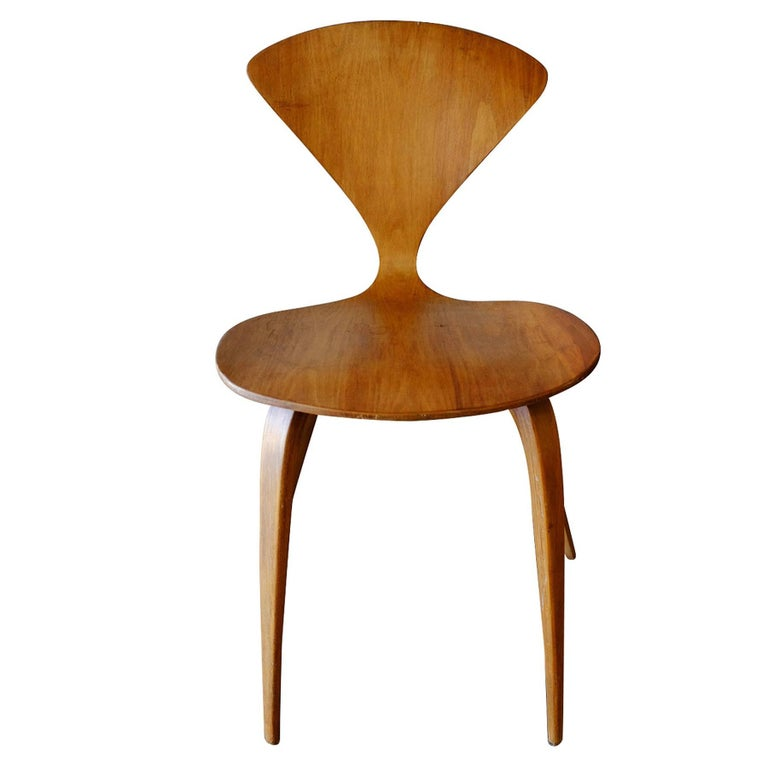 Set of four plycraft sculptural walnut dining chair designed by Norman Cherner made from steam form bent walnut plywood, circa 1950.