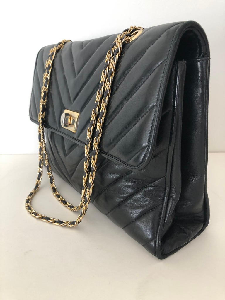 Black fine soft leather, channel design quilted large envelope shaped, double length long chain strap with leather woven, in very fine condition, top quality clean interior three compartment, zipper pouch . In the style of Chanel. Unmarked could be
