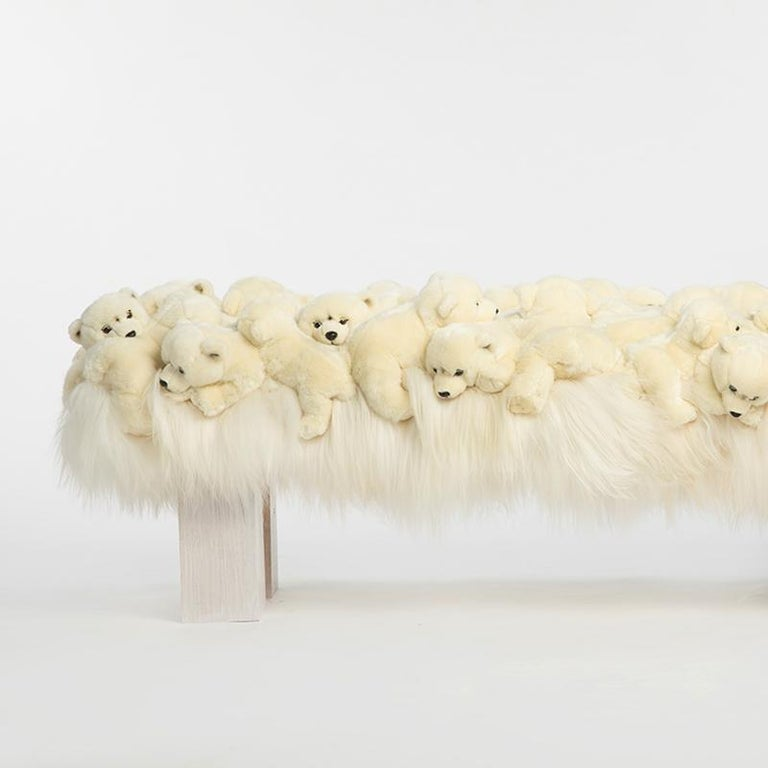 Bench polar bear made with small polar bears on all