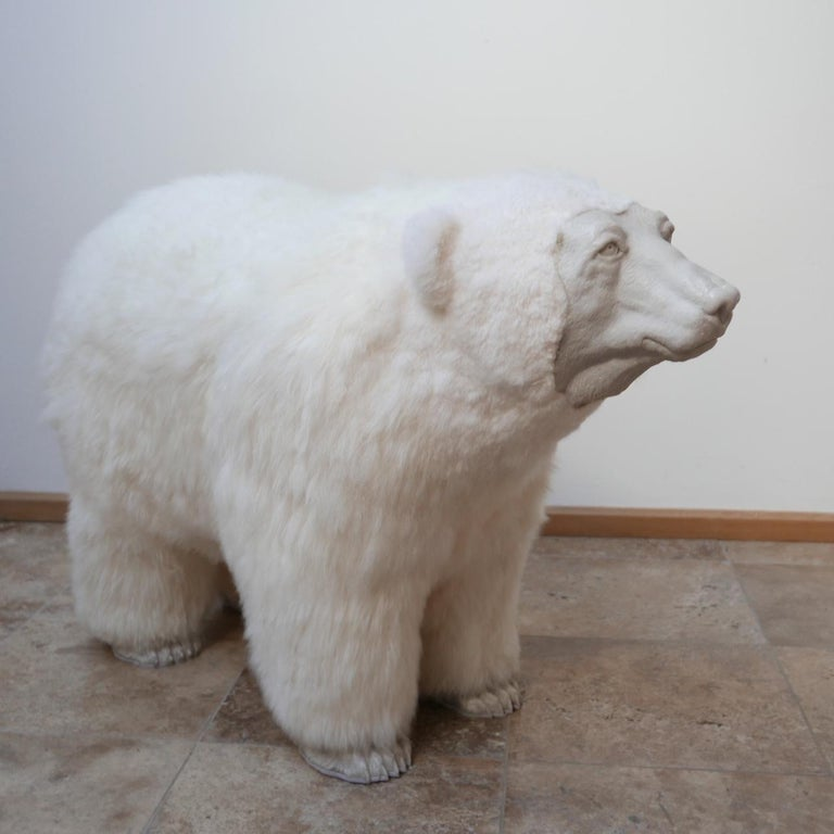 This amazing artist made Polar Bear is mixed-media created from high quality sheepskin over a foam and wooden sub-frame, carerra marble dust with resin forms the feet and face.  Almost any material is considered fair game for the art of sculpture.