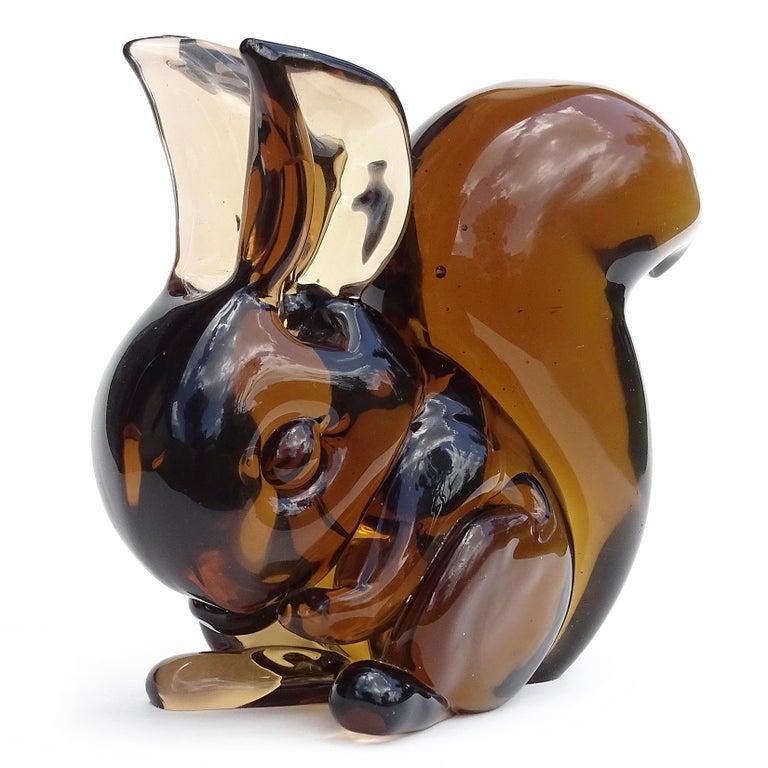 Beautiful, and cute vintage Murano hand blown Sommerso amber brown Italian art glass squirrel figure / sculpture. Documented to designer Flavio Poli for the Seguso Vetri d'Arte company, circa 1950s. Partial original label still attached, with item