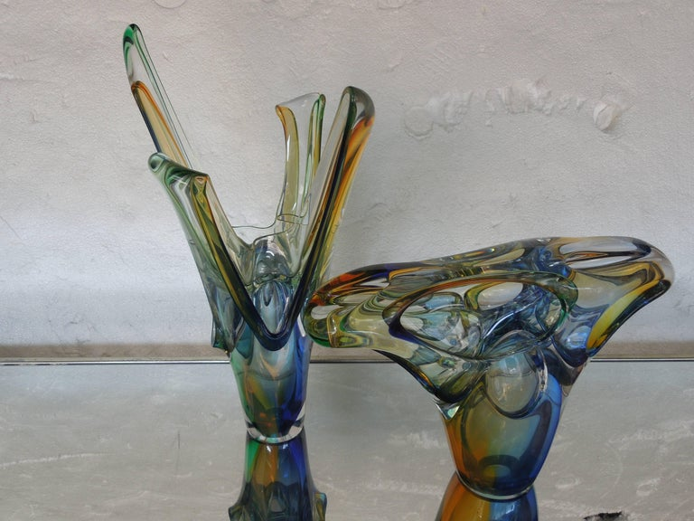 A spectacular piece of glass art. Sculpture by A. Jablanski. The multi-color (blue, amber, green) piece is amazing from all sides. This piece came from a multi million dollar Indian Wells, CA estate. Signed. Signed on bottom by artist.