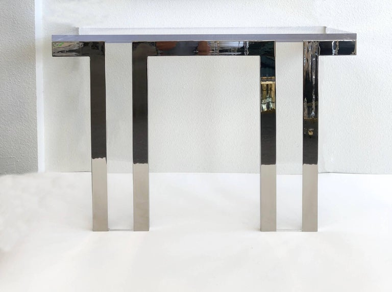 "A rare 1970s polish nickel and clear Lucite ""Box Line"" console table by renowned designer Charles Hollis Jones.