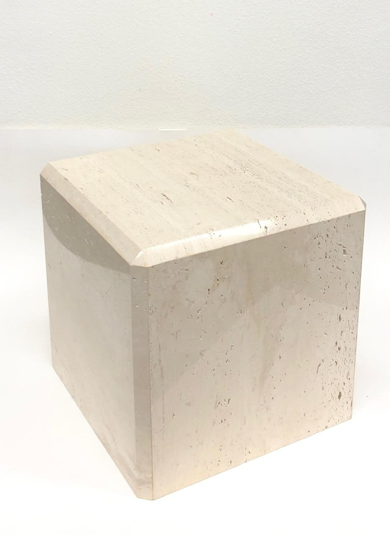 """A beautiful Italian travertine cube side table with the edges cut at 45 degrees, design by Kreiss collection in the 1980s. The table still retains part if the Kreiss label. Dimension: 18"""" wide, 18"""" deep, 18"""" high."""