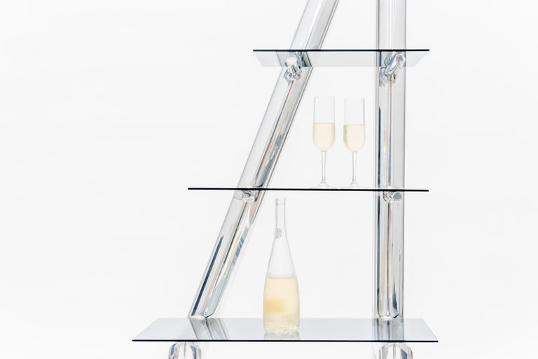 One of Deon Rubi's more iconic designs, the triangular Metro Shelf is a mix of masculine and feminine energy. Bold but delicate, with a flirty slant, this shelf, in the style of a 1980s-era étagère, can hold everything from precious objects to