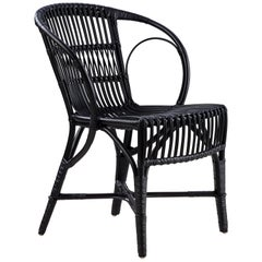 Polished Black Rattan Robert Wengler Indoor Armchair by Sika Design