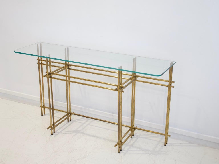 Italian console table and mirror from the late 1960s. Frame made of polished brass, tabletop of cut crystal.  Not that there is a small scratch on the mirror as seen on a photo.  Dimensions: console height 72 cm, width 130 cm, depth 36 cm; mirror