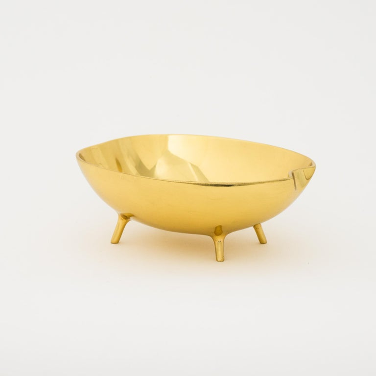 Charming and unusual handmade polished cast brass bowl.  Each of those original and elegant bowls are handmade individually. Cast using very traditional techniques.  Slight variations in polished finishes, patterns and sizes are characteristics