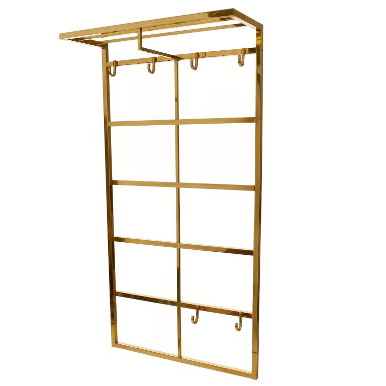 A polished brass coat rack manufactured in midcentury, circa 1960.