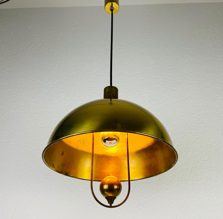 Polished Brass Pendant Lamp by Florian Schulz, 1970s, Germany In Good Condition For Sale In Hagenbach, DE