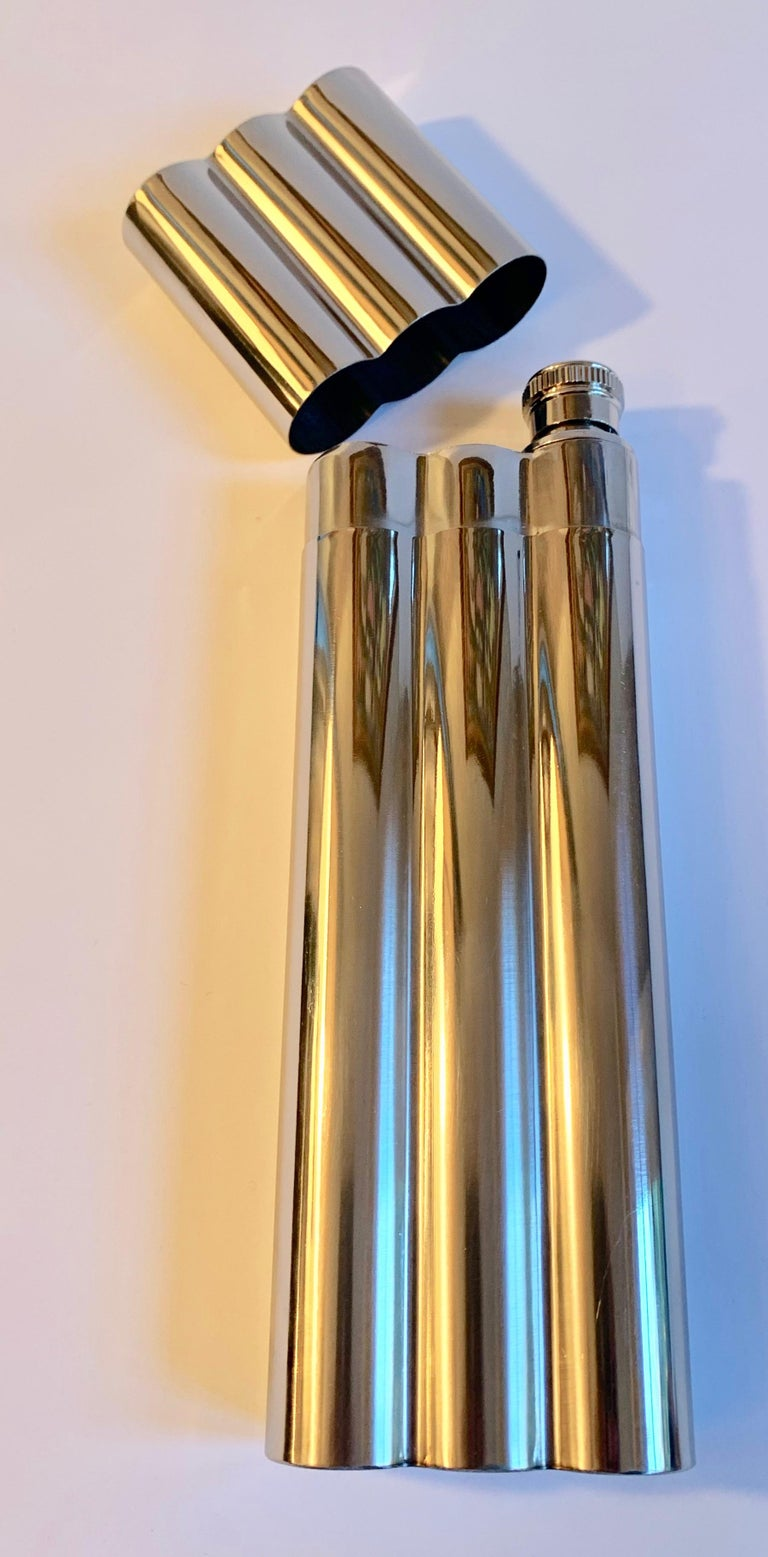 Polished chrome cigar holder with flask, this clever cigar holder will hold two cigars and your stash of favorite spirits, a great gift. Cigars, liquor, wine, 420.