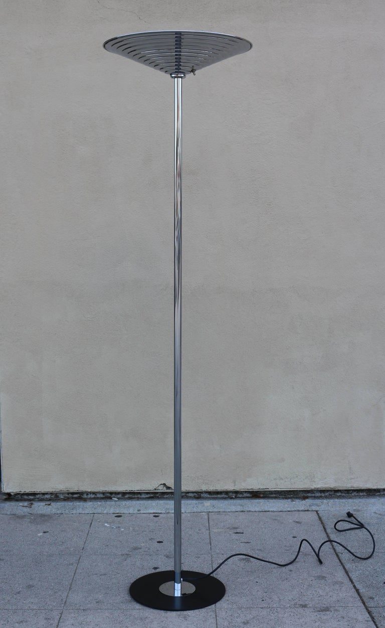 """Torchiere has a polished chrome stem and stepped shade. Shade measures 19"""" in diameter and base is 13"""" in diameter."""