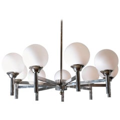"Polished Nickel ""Spoke"" Form Nine-Arm Chandelier with Frosted Glass Shades"