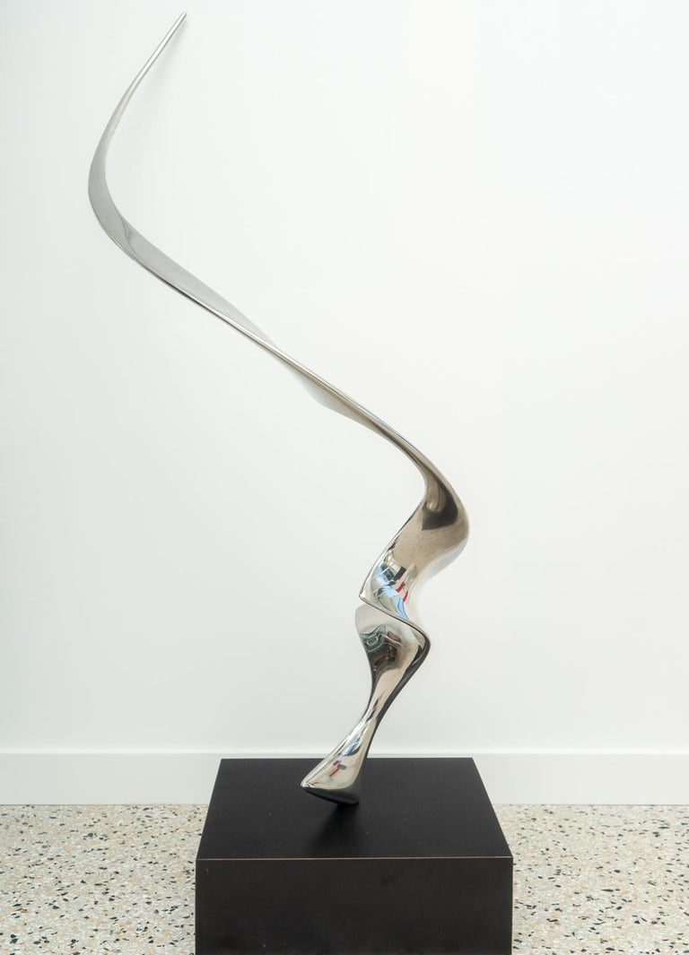 This stylish, chic and powerful polished stainless steel sculpture dates to the 1970s and was created by the American sculptor Louis Pearson.  Note: Base dimensions are 5