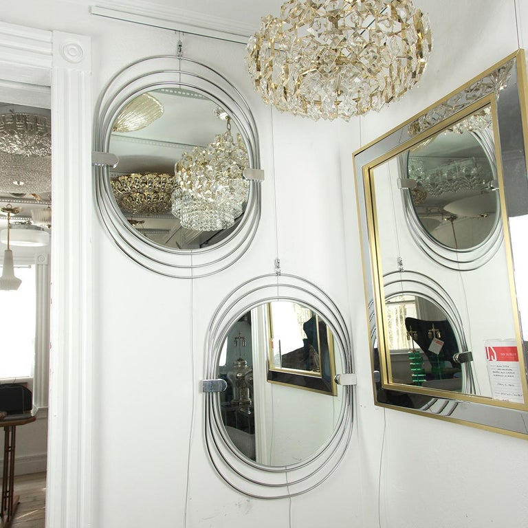 Polished stainless steel unusual oval mirror.