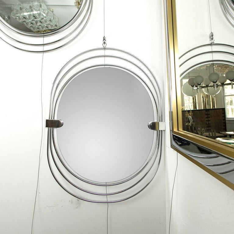 Italian Polished Stainless Steel Unusual Oval Mirror For Sale