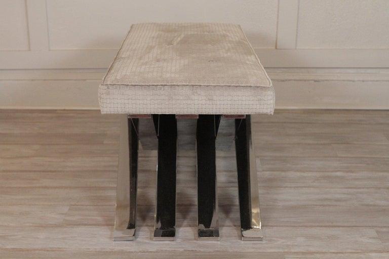 Polished steel Zig Zag bench with newly upholstered basket weave velvet top.