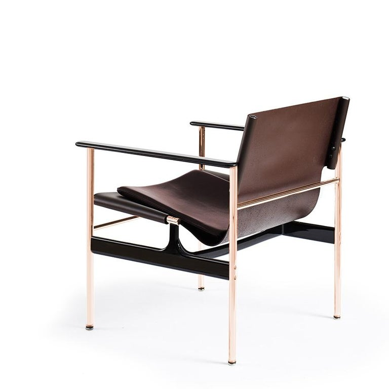 Designed in 1960 and originally manufactured from 1964-1979, the steel and leather 'sling chair' or '657', as it is commonly called, offers a refined combination of materials and finishes. Tubular steel legs connect to cast-aluminum arms and