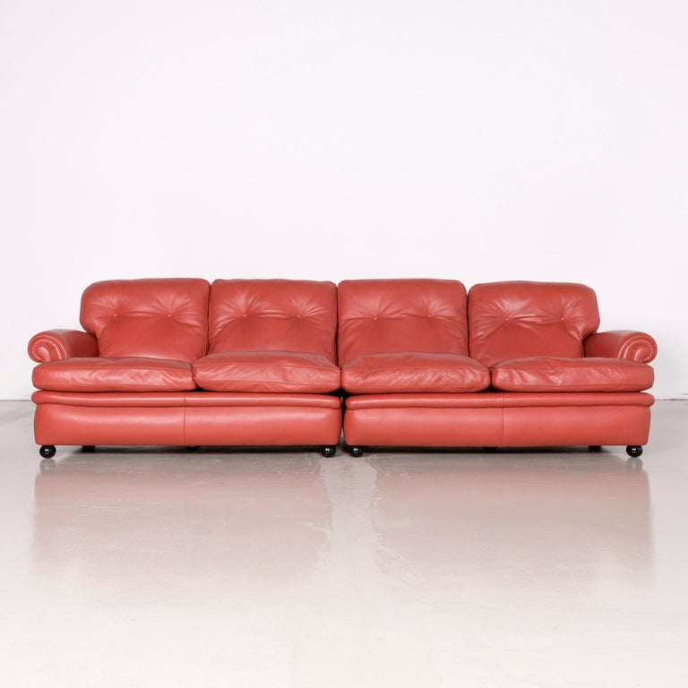 We bring to you a Poltrona Frau dream on sofa footstool set designer leather three-seat couch orange.