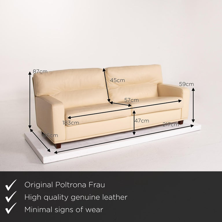 We present to you a Poltrona Frau leather sofa cream two-seat couch.      Product measurements in centimeters:    Depth 96 Width 217 Height 87 Seat height 47 Rest height 59 Seat depth 57 Seat width 183 Back height 45.