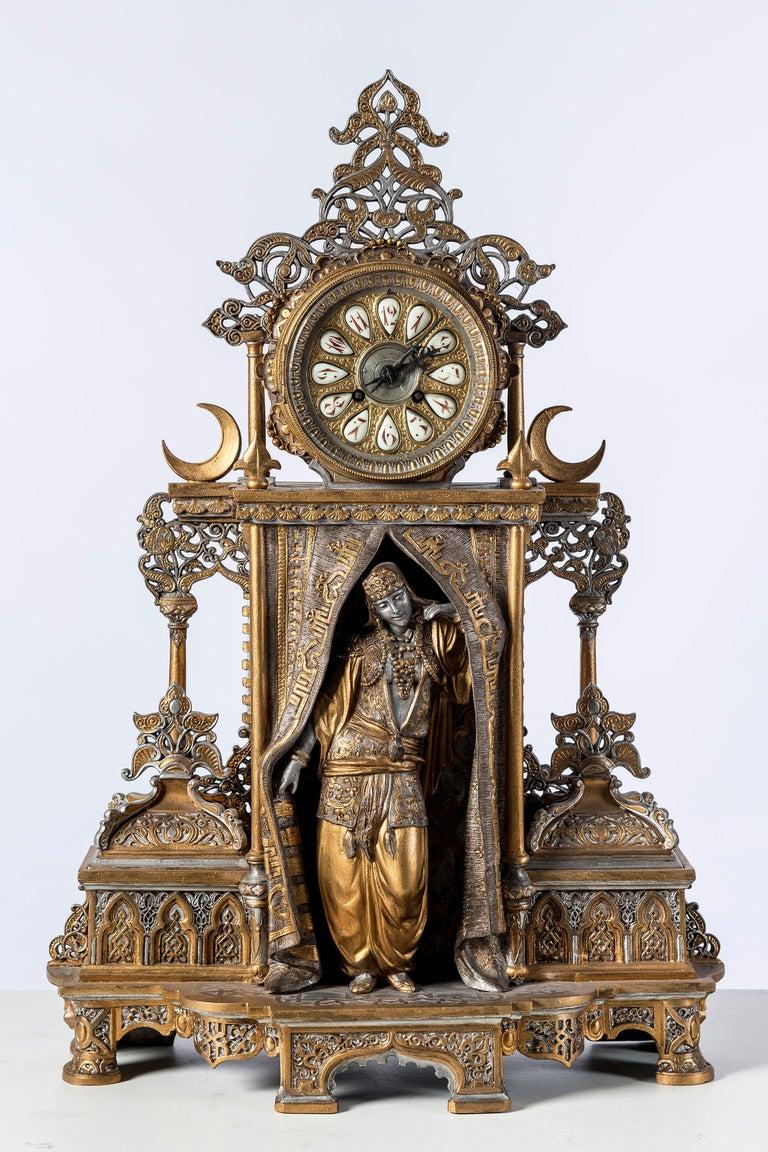 Polychrome alloy bronze garniture. Orientalist style, 1860. Machine clock signed 1570.