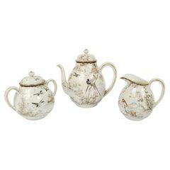 Polychrome Porcelain Teapot, Milk Jug and Sugar Bowl, Japan, Early 1900s