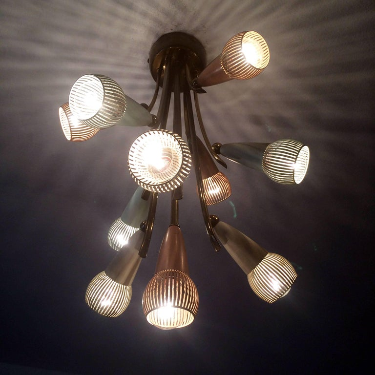 Polychromed sputnik chandelier with ten arms. Manufactured in Germany in 1950s. The lamp needs ten E14 screw fit bulbs.