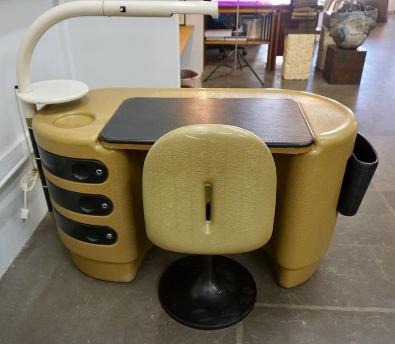 """Interesting molded polyurethane desk and chair with peoples names in the mold.The desk consists of a popup top, attached lamp, removable waste basket and three swivel drawers. Designed by Igl for Bayer AG, Germany. The desk measures 56"""" W x 28"""" H x"""