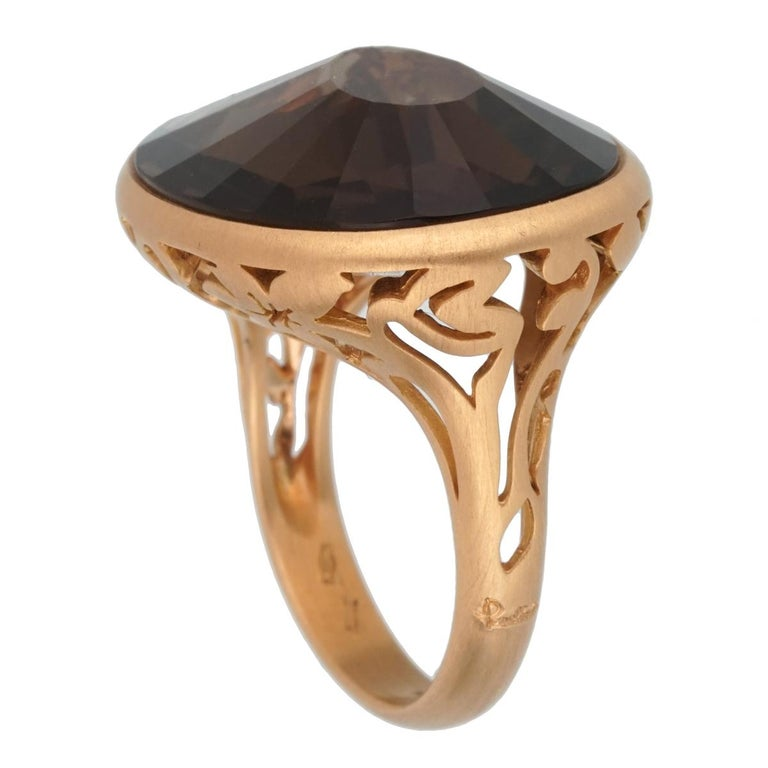 A chic brand new Pomellato cocktail ring showcasing a 10.19ct Smoky Quartz set in 18k rose gold. The ring measures a size 7.25 and can be resized  Pomellato Retail: $4600 Sku: 2453