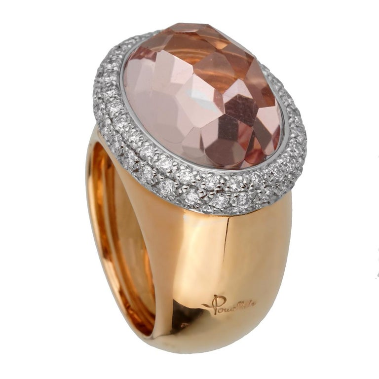A magnificent brand new Pomellato ring showcasing a 13.40ct Morganite stone wrapped by 1.20 ct of round brilliant cut diamonds in 18k rose gold. The ring measures a size 6.5 and can be resized.  Pomellato Retail Price: $14,500 Sku: 2447