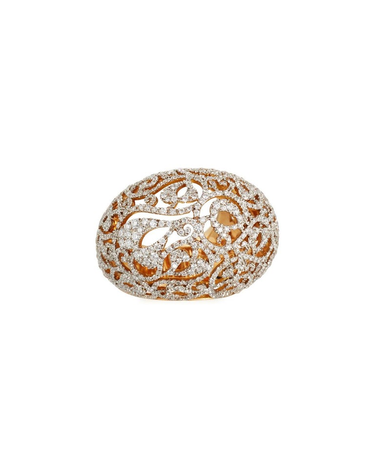 An impressive, one-of-a-kind ring featuring rounded volumes and glistening diamonds mounted on openwork with a see-through effect.  The latest additions to Pomellato's Arabesque collection surprise with their bold yet featherlight proportions.