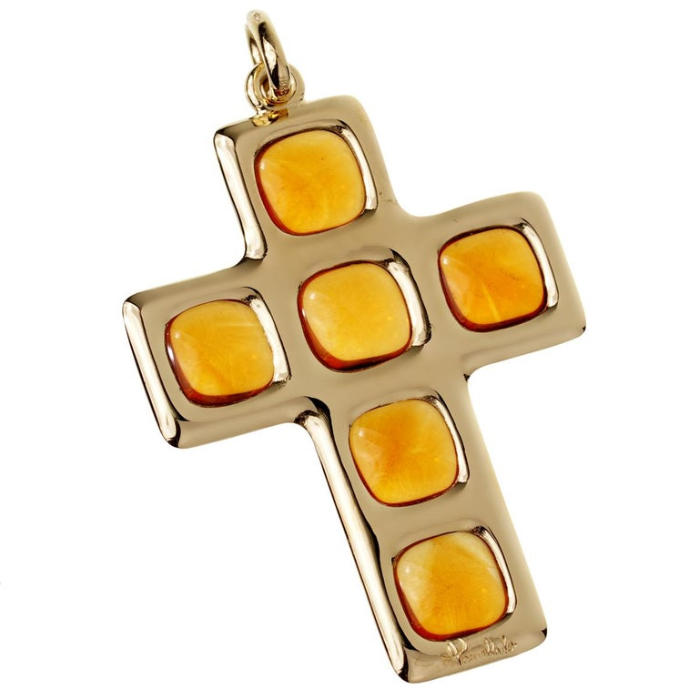 A fabulous Pomellato cross pendant showcasing 5 cabochon cut citrine stones weighing 27ct in 18k yellow gold. The pendant measures 2.51
