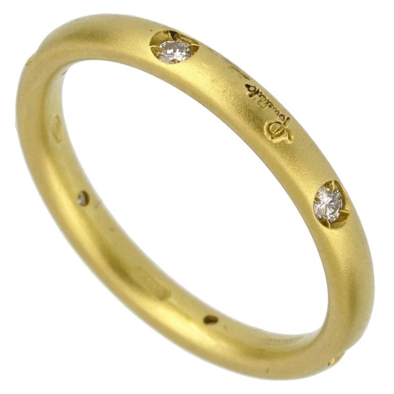 A chic brand new Pomellato diamond ring adorned with round brilliant cut diamonds in 18k yellow gold. The ring measures a size 4 1/4  Sku: 2359