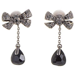 Pomellato Forever 18 Karat White Gold Onyx and Black Diamond Bow Earrings
