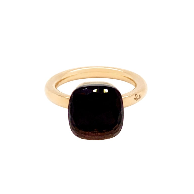 From the classic Pomellato 'Nudo' collection, a beautiful Smokey quartz measuring approximately 10mm x 10mm and weighs approximately 5.00 carat mounted in 18 carat rose gold. The ring features the classic Pomellato signature and hallmarks. UK finger