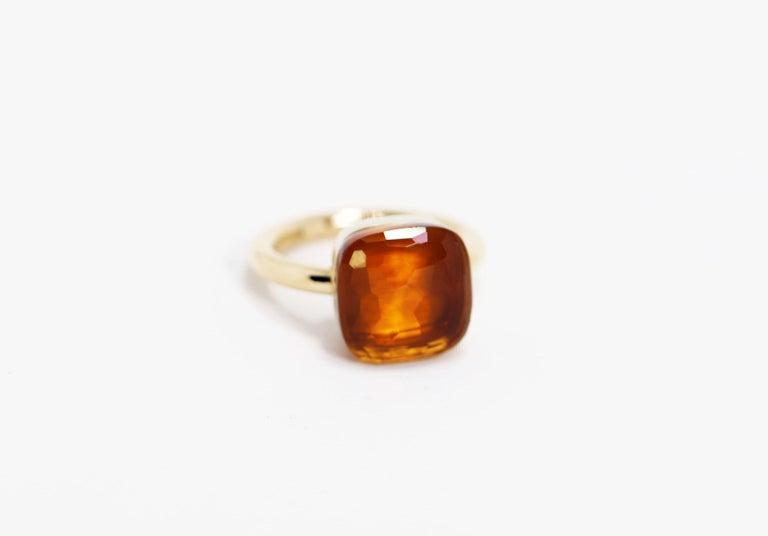 From Pomellato's most iconic collection, Nudo, this ring features a sleek, simplistic design characterised by a 'nude' citrine quartz stone measuring 12.5mm x 12..5mm and is mounted in 18 carat rose gold. The ring has the classic Pomellato signature