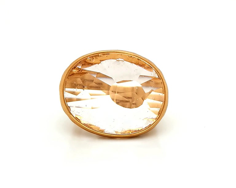 Unconventional cocktail ring designed by an Italian jewelry company Pomellato. The ring is decorated with a 10.19 carat briolette-cut quartz set in a filigree mounting. The metal is 18K rose gold. Weight of the ring is 13.53 grams. Signed