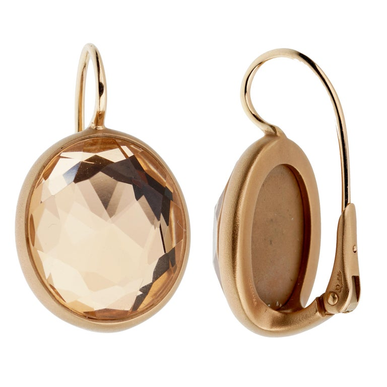An amazingly chic pair of Pomellato earrings with faceted quartz wrapped in satin finished 18k rose gold.