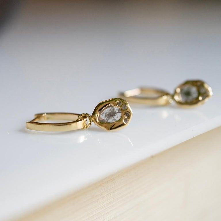 Cast set into 14 karat gold this one of a kind diamond slice charms gracefully hangs from 14 karat oval hinge hoops. Remove or add charms for a versatile look. The hoop can also be purchased separately (without charms).  -Price for hoop pair without