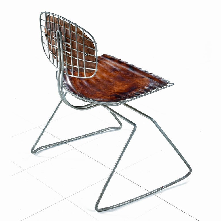 Sold as a pair The Beaubourg chair was conceived by Richard Rogers and Renzo Piano and designed specifically for the Pompidou Center in Paris. The final form was created by Georges Laurent and Michel Cadestin. The Beaubourg chair was selected as