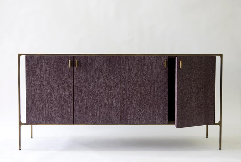 With the signature Lumifer brass 'T' component, the Ponte Credenza juxtaposes a delicate brass frame with a wooden monolith. Each of the two parts maintains its own language, materiality, and texture, making no effort to appear as a uniform body.